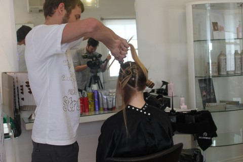 Model Courtney getting her hair done