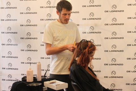 Stylist Luke working on Rose's hair